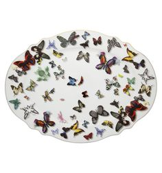 Christian Lacroix Butterfly Parade china collection with realistic graphic butterflies. Scalloped edging with gold details. Available on Alchemy Fine Home  www.alchemyfinehome.com
