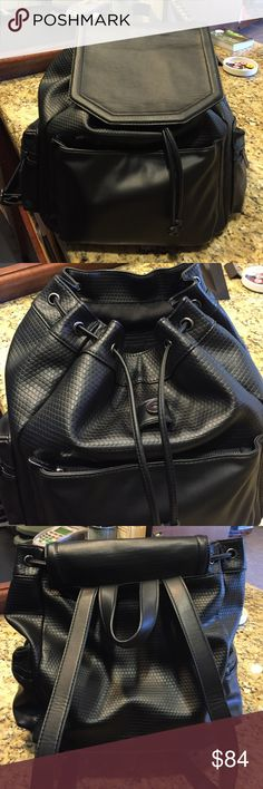 Leather backpack Topshop leather backpack- top magnetic snap with drawstring closure. Has front and side zip pockets. Lined. Soft faux leather material. Size- 11.5W 13.5H 13.5D. Great condition. Topshop Bags Backpacks