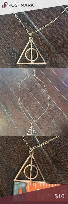 "Harry Potter Necklace Cute gold toned necklace. Deathly Hallows. Chain is 21"" plus a 2"" extender. New in package. Packaging is fashion jewelry packaging. It does not say Harry Potter anywhere on the packaging. Jewelry Necklaces"