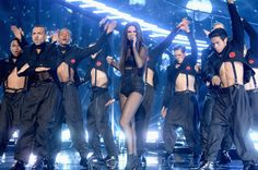 """Selena Gomez looked totally poised as she hit the stage at the 2015 American Music Awards at the Microsoft Theater in Los Angeles to perform her hit song """"Same Old Love,"""" showing one year can make quite the difference when remembering her tearful """"The Heart Wants What It Wants"""" performance last year."""