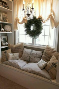Window seat...love this idea. Definitely having this idea built for our master bedroom! Love the chandelier