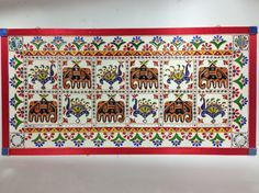 18x36Inches Lippan kaam or Lippan work is a traditional art form from Western India and is mainly done by women of the Rabari community of Kutch, Gujrat. This mud relief work is done on the inside mud