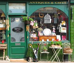 This is exactly what i would expect to see of an antique shop front, UK - so inviting! Does your shop front or website do the same for your customers?