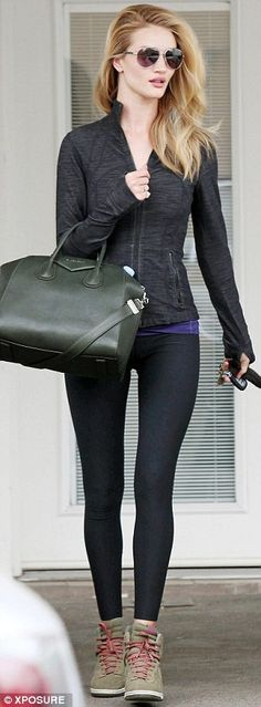 Rosie Huntington-Whiteley.. form-fitting.. black, army greens with a pop of blue..