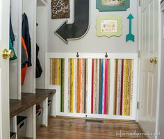 Multi-colored yardstick wainscoting adds a touch of fun to Beckie's laundry room/mud room at InfarrantlyCreative.net