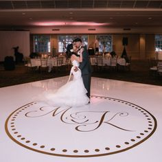 This timeless circle monogram dance floor decal is perfect to adorn the floor on…