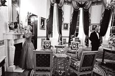 Hillary Clinton touching up in the Blue Room for the National Governors' Association Dinner at the White House in February 1996 with longtime butler James Jeffries, right, on duty.  Courtesy of the William J. Clinton Presidential Library, National Archives and Records Administration.