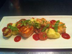 Roasted atlantic salmon and seared scallops, mash potatoes, sugar snappeas and capsicum dressing.