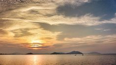 09 Sept. 18:10 うす雲越しに見える博多湾の夕陽です。 ( Evening Now at Hakata bay in Japan)