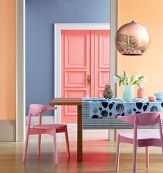 Spring/Summer 2018 is all about using a bright colour palette, whether delicate pastels or vibrant bolds. Here, blue, golden yellow, coral and pink clash wonderfully in this dining room, with a copper pendant light providing a focal point. (Photo: Valspar paints)