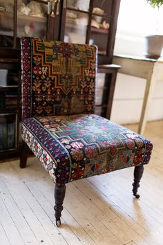 I like the idea of using a rug for upholstery, though I have no idea how one finds oriental rug fragments for a price that would make it worth while.