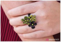 How Does Your Garden Grow? Item #: P4WH-GRBK-003XX Two flowers in complementary shades of green are paired with a black flower in an antiqued finish. Each flower is dotted with brilliant green rhinestones for flawless light-catching detail. Features an adjustable band.  Sold as one individual ring.