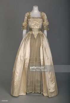 Wedding dress, 1916 (front detail view). Silk satin, lace, silk flowers by Lucile.