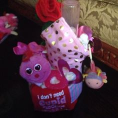Girl Valentine Diaper Cake receiving blanket I don't need Cupid  onesie Mink & pink bib Heart teether Bottle  Stuff Valentine caterpillar  Clip on mirror rattle caterpillar  Stuff rose    Diapers Will be wrap in plastic with ribbon Other
