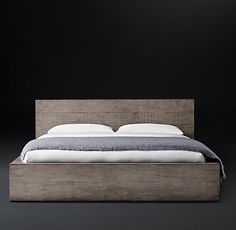 RH's Monterey Panel Bed:Our collection from designer Thomas Bina features reclaimed peroba rosa, a dense hardwood native to Brazil. Salvaged from old barns and dwellings, the timbers reveal time-touched character. Natural variations in grain and hue bring warmth to the clean, geometric silhouette.