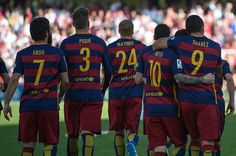 Barcelona's players celebrate their 24th La Liga title at the end of the Spanish league football match Granada CF vs FC Barcelona at Nuevo Los Carmenes stadium in Granada on May 14, 2016. Barcelona sealed their 24th La Liga title as Luis Suarez took his tally for the season to 59 goals with a hat-trick in a 3-0 win at Granada to hold off Real Madrid's late-season surge.