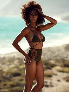 Ursula Crochet 2 piece Swimsuit. Organic cotton/spandex. High waist bottom is crocheted front and back sides. Adjustable triangle top can be wrapped and tied as you wish. A high fashion eco friendly addition to your wardrobe. Available in Black, White, Olive, Red, Purple.