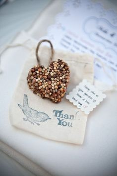 DIY Birdseed favors using: Silicon molds (like heart shaped cupcake molds), Edible gelatine powder, Wild birdseed (Find a mix for your local birds), Metal bowl, Twine and Scissors.