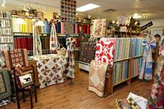 Quilters find green pastures at a well-established shop filled with fabrics and ideas. Divider, Quilting, Fabrics, Gift Wrapping, Store, Room, Furniture, Home Decor, Tejidos