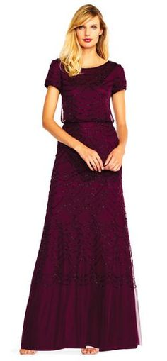 1dc53d2ba2f Classic charm and effortless sparkle team up in this gorgeous evening gown  featuring an art deco