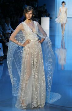 shoulder veil...for the reception? Cape - for wedding wonder woman!