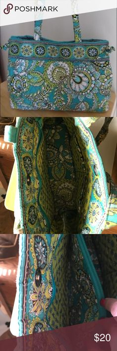 Vera Bradley Shoulder Bag Peacock Paisley Gently used Vera Bradley side tie tote/ Shoulder Bag in green peacock paisley. Great condition. See my store for matching zip around wallet and create a bundle for a discount! Bag measures 10.5 inches tall and 4.5 inches deep. Vera Bradley Bags Shoulder Bags