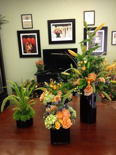 Multiple arrangements using similar flowers and foliage.  A great way to change the look and composition of every table. I love the grasses. Dave