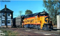 B&O GP40-2 #4341 passes NS Tower in Lima, Ohio with a cut of loaded autoracks during September of 1983.: