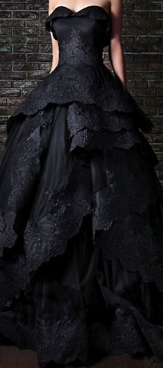 This black wedding gown could be worn again as a ball gown and no one would know...I remember wanting a black wedding dress! This is so beautiful !