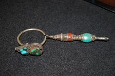 "Old large (13,5 cm) Tibetan silver earring with turquoise and coral, worn in Tibet singularly by men. First half 20° century (the turquoise bead on the lower part was probably replaced later on). Price: on request. Reference literature: ""Jewelry of Tibet and the Himalayas"", John clarke, V&A Publications, pag.: 74 - 93   For more information, please email me at didiergregoire03@gmail.com"