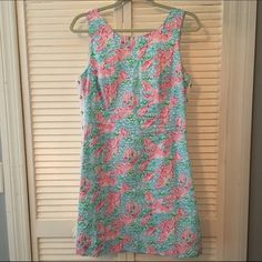 Lilly Pulitzer Lobstah Roll Delia Dress EUC Lilly Pulitzer Lobstah Roll Delia Dress. Size 8.  Pretty lace up detail on the side. Purchased in EUC and only worn once (it's a little short on me!). Would much prefer to trade for a larger size, since it's a holy grail find! Lilly Pulitzer Dresses