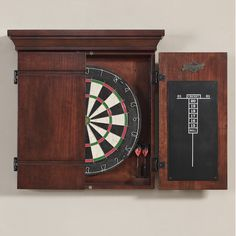 Features: -Door material: Solid Wood on the front. -Cabinet material: MDF with veneer. Product Type: -Dartboard and Cabinet Set. Darts Included: -Yes. Scoreboard Included: -Yes. Dartboard Cabinet Plans, Dartboard Setup, Gun Cabinet Plans, Cabinet Doors, Garage Game Rooms, Dart Board Cabinet, Dart Set, Woodworking Inspiration, Woodworking Ideas