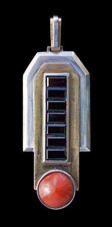 ART DECO Modernist Pendant   Silver, gold, onyx & coral   Length: 7 cm (2.7 in)  Width: 2.4 cm (0'9 in)  Cased by: Bonnefois  The silk marked:   Bijoux Anciens, Objects d'Art  Bonnefois  17, Rue Tronchet, Paris ca 1925
