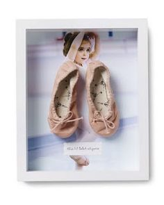 What a great idea to display not only your adorable ballerina but also her first pair of ballet shoes, love this!