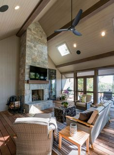 This transitional mountain home designed by The Architectural Practice is located in The Cliffs at Walnut Cove in Asheville, North Carolina. Natural Landscaping, Modern Fire Pit, Blinds Design, Modern Rustic Homes, Modern Craftsman, North Carolina Mountains, Mountain Modern, Fireplace Surrounds, Custom Cabinetry