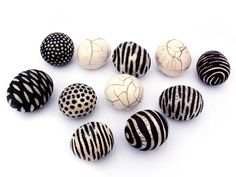 by Camille Campignion. These are actually ceramic beads, but could easily be reproduced in polymer clay.