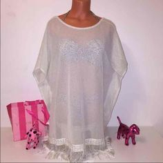 NEW VS SHIMMERING FRINGE COVER UP Victoria's Secret  SHIMMERING MESH FRINGE COVER UP WITH HOLES FOR ARMS AND SLITS IN BOTH SIDES!  COLOR IVORY PEARL  SIZE  MEDIUM RETAIL PRICE $88  FAST SHIPPING!!!✅✅✅   Check out my other items! I am sure you will find something that you will love it! Thank you for watch!!!!!  Be sure to add me to your favorites list! Victoria's Secret Swim Coverups