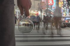 glassporthole opens round windows in the air. Attempt to convert the ordinary landscape into a meaningful scene. Tokyo, Magnifying Glass, Crystal Ball, Pixel Art, Crowd, Art Photography, Digital Art, Photos, Street View