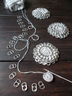 A crochet flower purse, made from little pop tabs from soda. What do you do with these little pop tabs after drinking all the soda and beer? You can make beutiful crochet pop tab projects, as … Read more. Soda Tab Crafts, Can Tab Crafts, Bottle Cap Crafts, Diy Bottle, Tape Crafts, Crochet Diy, Crochet Baby Shoes, Crochet Converse, Knitted Baby