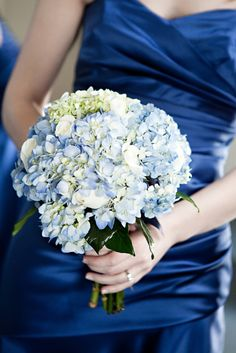 love the blue hydrangeas and the dark blue dresses
