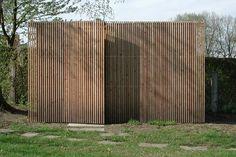 Flakes, vertical wooden elements, wooden facade, addition, garden, door