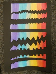 We painted vertical lines in arainbow with watercolor. We cut horizontal lines with our scissors and glued them to a black background. T...