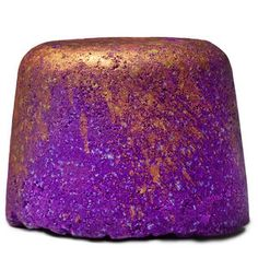 This Bath Bomb is a tribute to our belief that great things can rise out of the ashes, just like the mythical Phoenix. Royal purple and gold-dusted, with a cinnamon stick in the center, this gorgeous bomb sinks to the bottom of the tub when you toss it in, and slowly rises up, fizzing out a spicy apple and cinnamon scent.