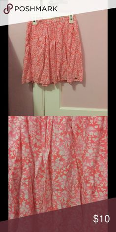 Pink floral skater skirt A pink skater skirt with white flowers its flowy and super cute! Has been worn multiple times Hollister Skirts Circle & Skater