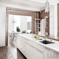 Placed in the centre of the room, this sleek island adds a contemporary edge while preserving the original features of this classical home. Want more kitchens inspiration? Pick up our April issue, which includes a free copy of our 100-page ELLE Decoration Kitchens supplement! http://ellede.co/1Sm5GMK #home #sweethome #bathroom #decor #design