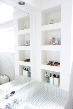 White bathroom.    Get rid of the medicine cabinet in kids bathroom. built-in wall cubbies