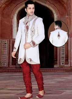 Make a classy impression, dressed with this White Brocade Sherwani. All patterns are intricately embellished with Butta Work, Crystals & Stones, Resham & Velvet Patch work....
