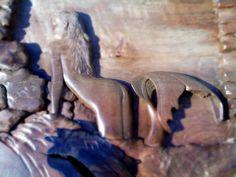 Sereia esculpida em madeira