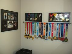 love the idea of using a curtain rod to display race medals