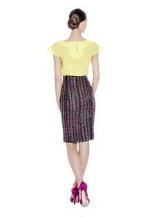 A richly textured handwoven boucle tweed finished pencil skirt that shows off your figure-flattering silhouette. Team with matching coat for formal or casual looks.  Handwoven boucle fabric imported from France with stretch viscose lining. Washcare: Dry clean MADE IN EUROPE